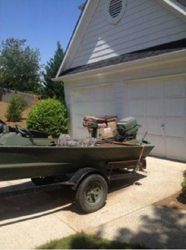 $1 Great river/duck/fishing boat (Cumming)