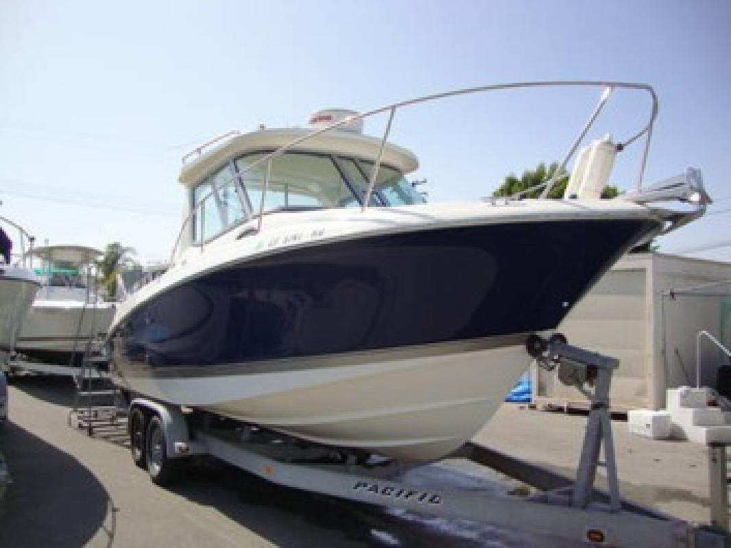 Used 252 pilot house fishing boat by wellcraft twin yamaha for Pilot house fishing boats