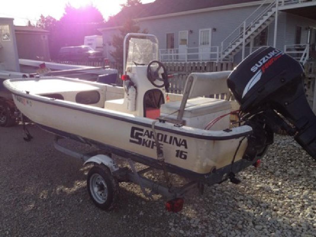 $3,899 OBO 1995 Carolina Skiff 1655 Dlx Cc 2005 F40 Suzuki & Trailer