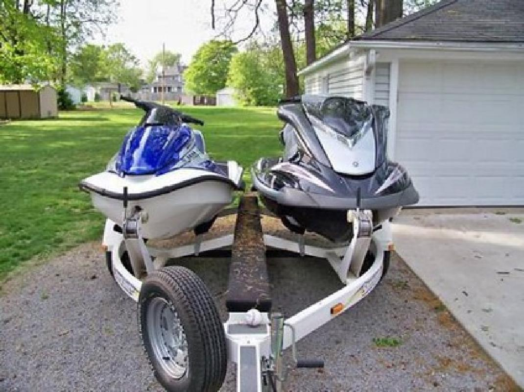 $2,480 2006 Yamaha & 2005 Honda PWC on Dual Trailer