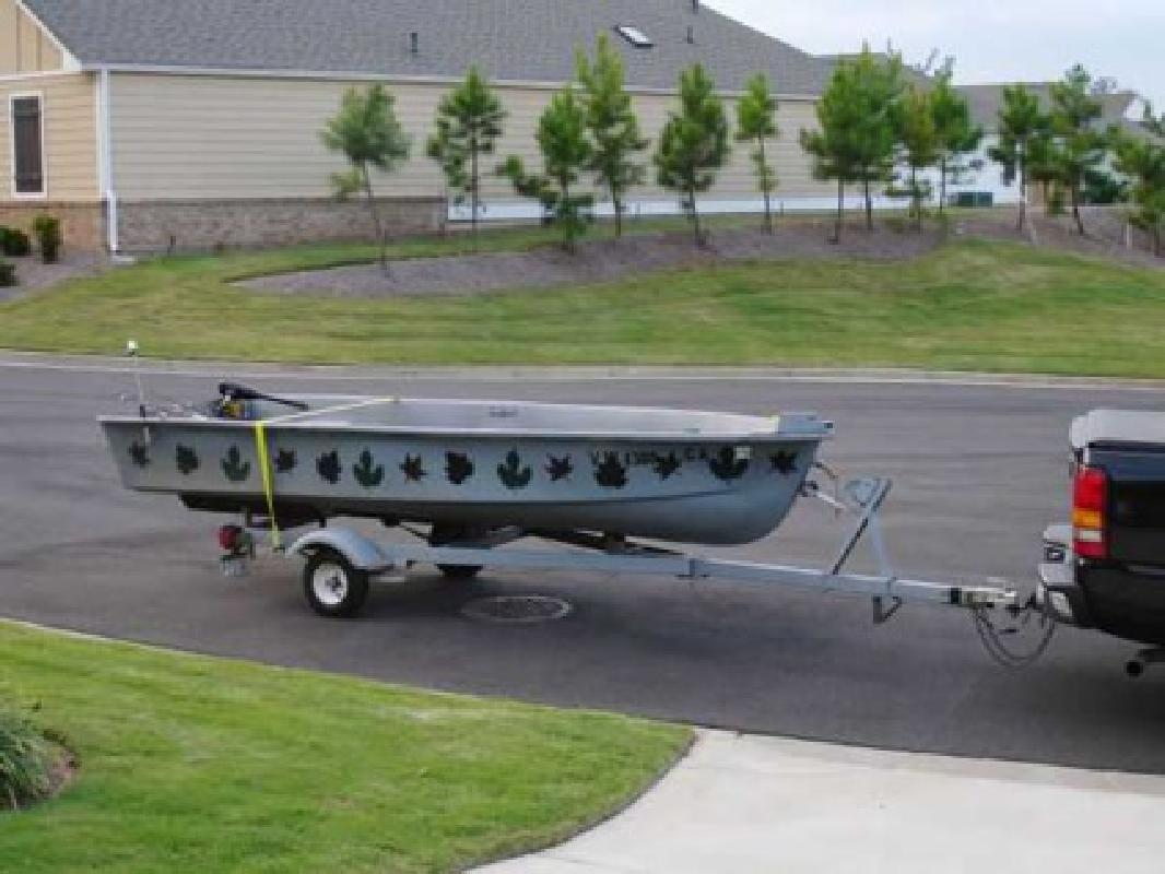 $995 14-ft. v hull w/ trailer and motor. (Canton)